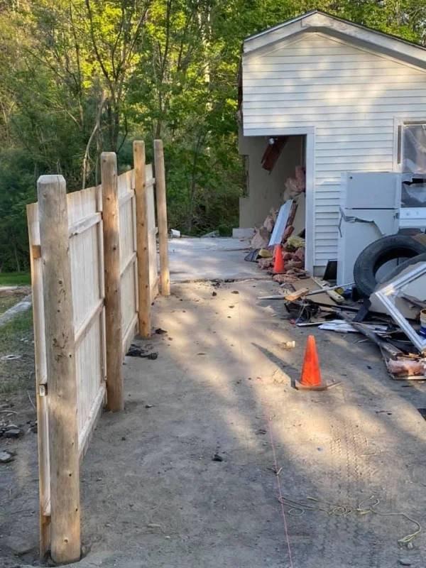 Property Dispute: Man Got Half Of His Neighbors Garage (9 pics)