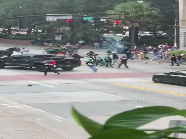 Man Throws Smoke Canister And Draws Weapon On Protester