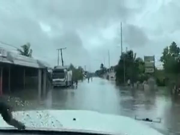 Riding On Flooded Street