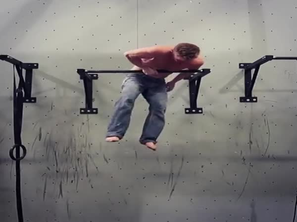 One Arm Muscle Up By Rock Climber