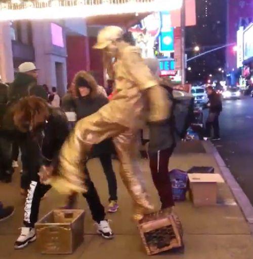 NYC Busker Breaks Character To Break Thugs Face