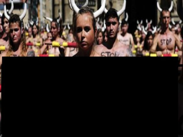 Hundreds Of People Go Topless To Protest The Running Of The Bulls